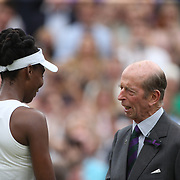 LONDON, ENGLAND - JULY 15:  Venus Williams of The United States receives her runners up trophy from Prince Edward, Duke of Kent after the Ladies Singles Final in the Wimbledon Lawn Tennis Championships at the All England Lawn Tennis and Croquet Club at Wimbledon on July 15, 2017 in London, England. (Photo by Tim Clayton/Corbis via Getty Images)