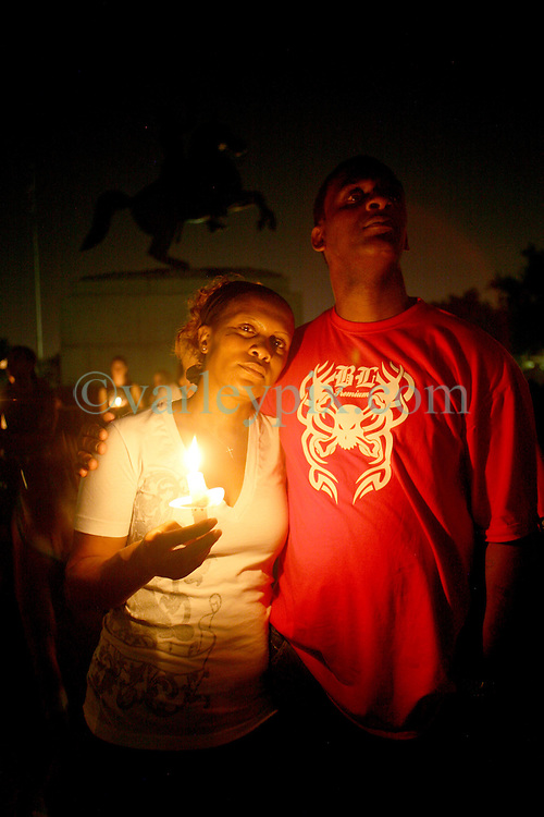29 August 2007. New Orleans, Louisiana. <br /> Candlelit vigil, St Louis Cathedral, Jackson Square. Antoinette and Tyrone Hudson pay their respects with hundreds of people gathered to remember the many victims of Hurricane Katrina on the evening of the second anniversary. <br /> Photo credit; Charlie Varley.