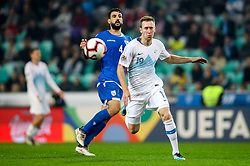 Giorgs Merkis of Cyprus and Robert Beric of Slovenia during football match between National Teams of Slovenia and Cyprus in Final Tournament of UEFA Nations League 2019, on October 16, 2018 in SRC Stozice, Ljubljana, Slovenia. Photo by  Morgan Kristan / Sportida