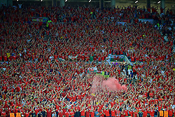 LYON, FRANCE - Wednesday, July 6, 2016: Wales supporters sing despite the 2-0 defeat to Portugal during the UEFA Euro 2016 Championship Semi-Final match at the Stade de Lyon. (Pic by David Rawcliffe/Propaganda)