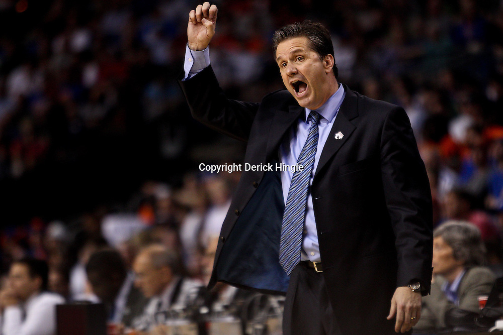 Mar 19, 2011; Tampa, FL, USA; Kentucky Wildcats head coach John Calipari during the second half of the third round of the 2011 NCAA men's basketball tournament against the West Virginia Mountaineers at the St. Pete Times Forum. Kentucky defeated West Virginia 71-64.  Mandatory Credit: Derick E. Hingle