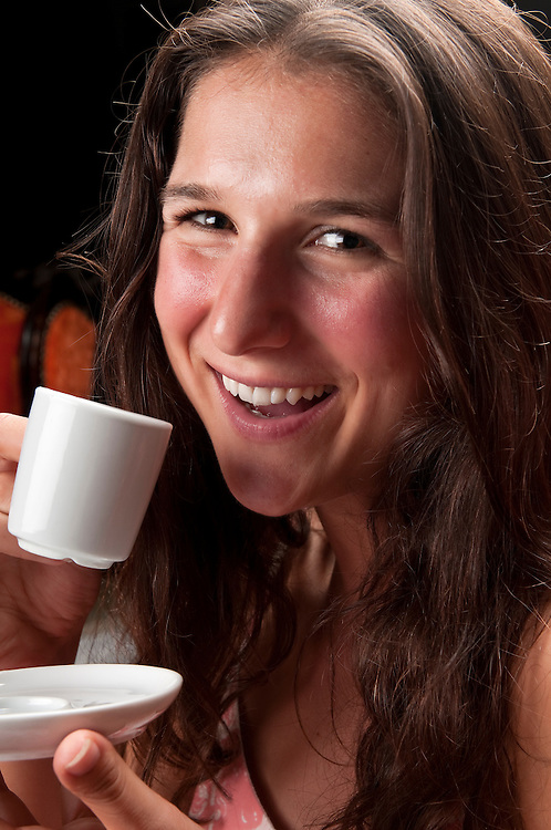 Young woman very happy drinking coffee