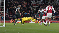Football - 2017 / 2018 Premier League - Arsenal vs. Manchester City<br /> <br /> Ederson Moraes (Manchester City) dives at the feet of Danny Welbeck (Arsenal FC) in a rare Arsenal chance at The Emirates.<br /> <br /> COLORSPORT/DANIEL BEARHAM