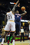 March 27, 2011; Cleveland, OH, USA; Atlanta Hawks power forward Josh Smith (5) shoots over Cleveland Cavaliers power forward J.J. Hickson (21) during the fourth quarter at Quicken Loans Arena. The Hawks beat the Cavaliers 99-83. Mandatory Credit: Jason Miller-US PRESSWIRE