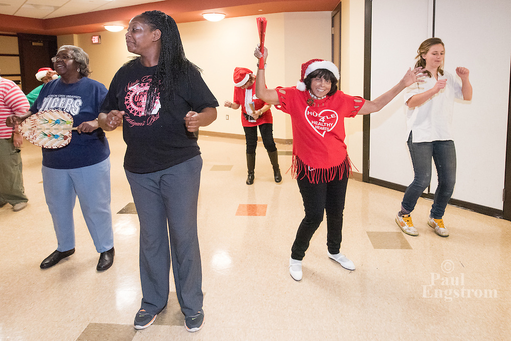 Ninety-year-old dancer Josie Huygie, right center, line-dances The Wobble at the Wright Museum of African American History in Detroit.