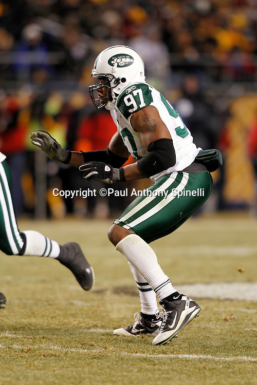 New York Jets linebacker Calvin Pace (97) rushes the quarterback during the NFL 2011 AFC Championship playoff football game against the Pittsburgh Steelers on Sunday, January 23, 2011 in Pittsburgh, Pennsylvania. The Steelers won the game 24-19. (©Paul Anthony Spinelli)