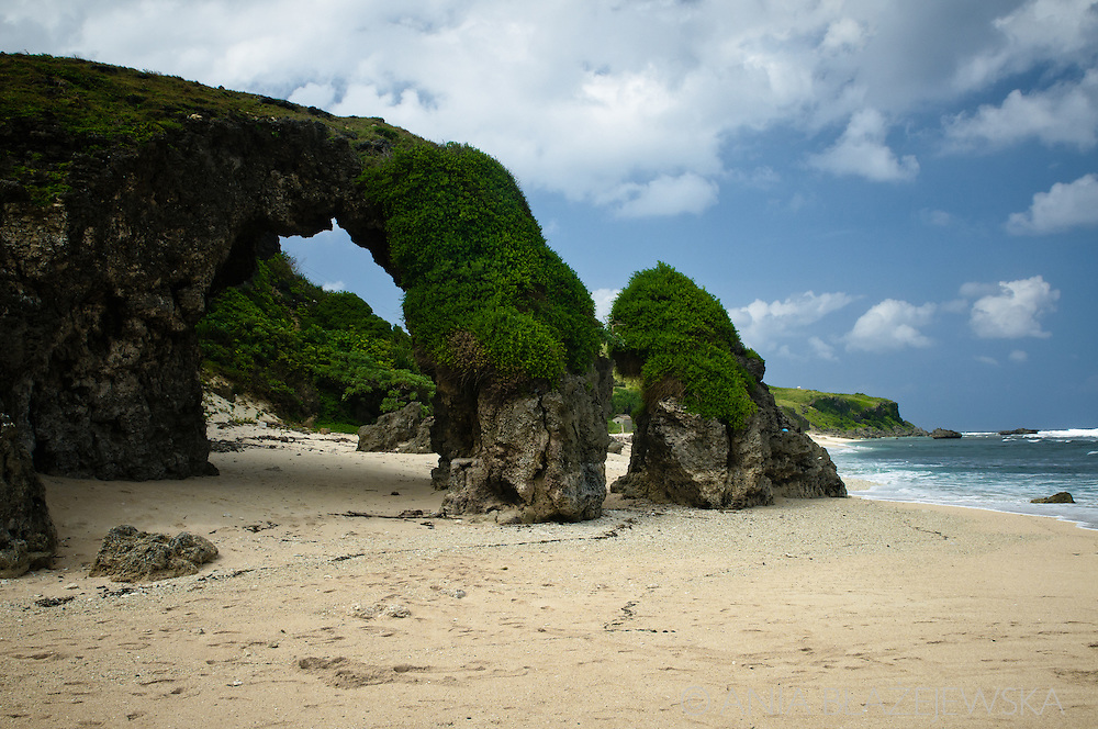 Philippines, Batanes. Nakabuang, a beach on Sabtang Island famous for its beautiful arch.
