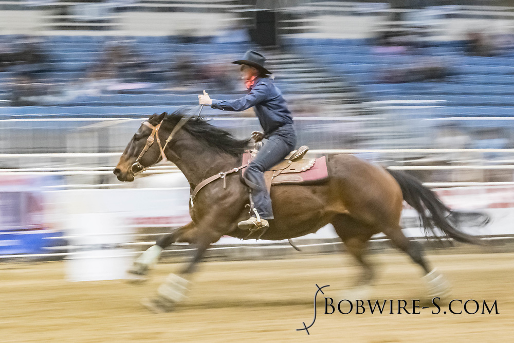 Barrel racer Jackie Schau makes her run during slack at the Bismarck Rodeo on Saturday, Feb. 3, 2018. She had a time of 14.01 seconds. This photo and more from most runs are available at Bobwire-S.com.