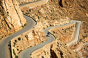 The winding, meandering mountain road is famous for driving and runs inside the Dades Gorge and through the Dades Valley like a river, Southern Morocco 2016-05-13.<br /><br />This main road known as being the 'road of a thousand kasbahs' stretches from Ouarzazate to Tinghir, curving it's way through gorges and stunning arid landscapes which are naturally eroded by the winds from the Sahara desert. <br /><br />The region offers stunning trekking, hiking, driving and cyclying routes throughout the gorge, oasis palmeries which are built alongside the Oued Dades (Dades river) and the crumbling derelict kasbahs.