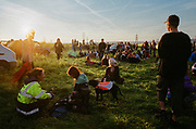 Ravers take a seat from all that partying, Avonmouth, Bristol, UK, June 2014