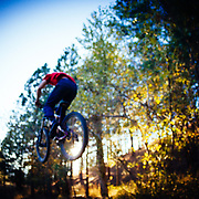 Abraham Jindrich gets air off a jump in the woods of Missoula, Montana.