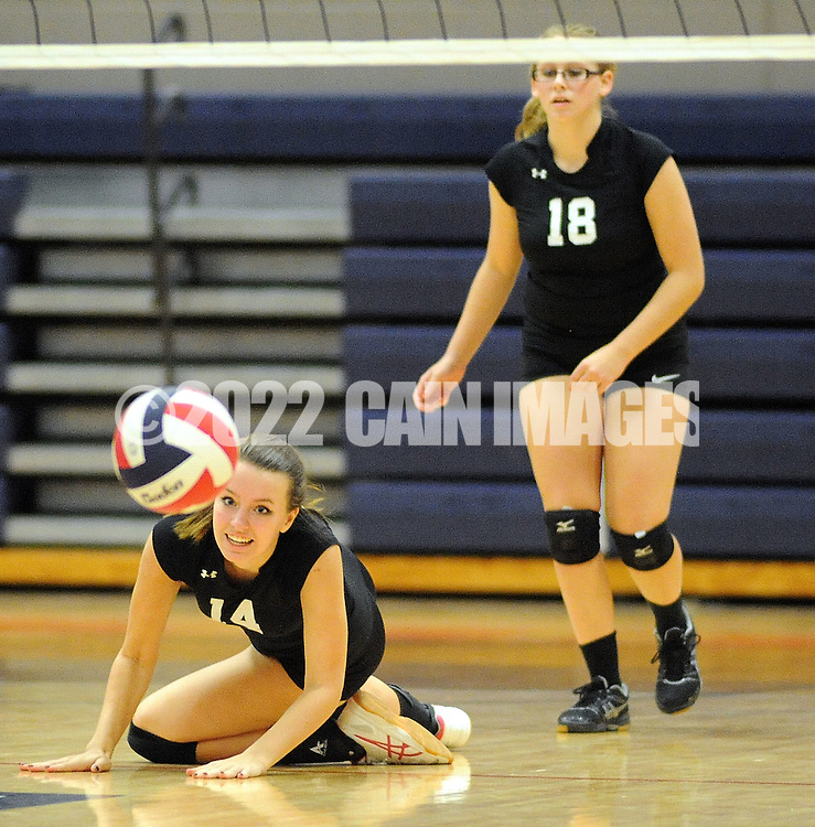 William Tennent's Shaina Gatton #14 dives in an attempt to volley the ball as her teammate Steph Woolston #18 backs her up against Central Bucks East during a District One first round volleyball match Tuesday October 27, 2015 in Buckingham, Pennsylvania. (Photo by William Thomas Cain)