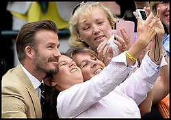 Image ©Licensed to i-Images Picture Agency. 28/06/2014, Wimbledon, London, United Kingdom. David Beckham posing for selfies with fans beside the  Royal box on Day 6 of the Wimbledon Tennis Championship. Picture by Andrew Parsons / i-Images