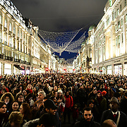 Attendees at Regent Street Christmas Lights switch-on celebrate its 200th anniversary on 14 November 2019, London, UK.