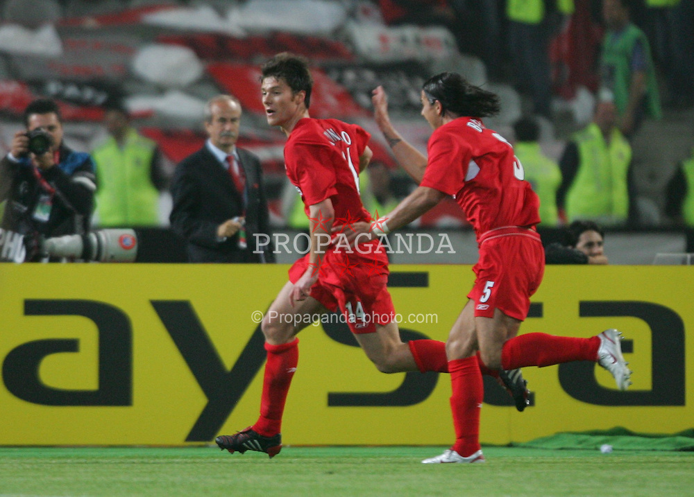 ISTANBUL, TURKEY - WEDNESDAY, MAY 25th, 2005: Liverpool's Xabi Alonso celebrates scoring the equaliser from the re-bounded penalty kick with Milan Baros during the UEFA Champions League Final at the Ataturk Olympic Stadium, Istanbul. (Pic by David Rawcliffe/Propaganda)