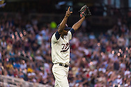 Samuel Deduno #21 of the Minnesota Twins celebrates after Aaron Hicks #32 (not shown) made a diving catch against the Milwaukee Brewers on May 29, 2013 at Target Field in Minneapolis, Minnesota.  The Twins defeated the Brewers 4 to 1.  Photo: Ben Krause