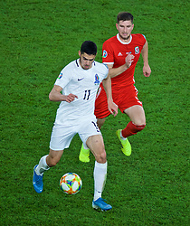CARDIFF, WALES - Friday, September 6, 2019: Azerbaijan's Ramil Sheydaev (L) and Wales' Chris Mepham during the UEFA Euro 2020 Qualifying Group E match between Wales and Azerbaijan at the Cardiff City Stadium. (Pic by Paul Greenwood/Propaganda)