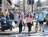 Pedestrians walk on Main Street enjoying a beautiful day Sunday February 28, 2016 in New Hope, Pennsylvania. It was unseasonably warm Sunday in Bucks County and people flocked in droves to New Hope. (Photo by William Thomas Cain)