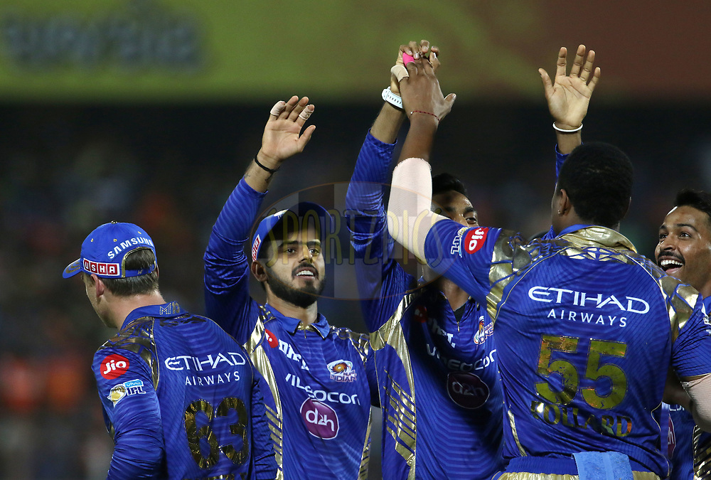 Mumbai Indians players celebrates the wicket of Gujarat Lions captain Suresh Raina during match 35 of the Vivo 2017 Indian Premier League between the Gujarat Lions and the Mumbai Indians  held at the Saurashtra Cricket Association Stadium in Rajkot, India on the 29th April 2017<br /> <br /> Photo by Vipin Pawar - Sportzpics - IPL
