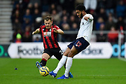 Ryan Fraser (24) of AFC Bournemouth closes in on Joe Gomez (12) of Liverpool during the Premier League match between Bournemouth and Liverpool at the Vitality Stadium, Bournemouth, England on 7 December 2019.