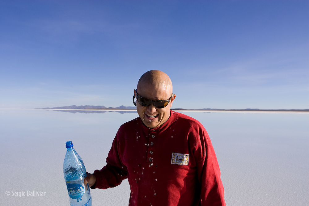 Oscar Ebert driving and guiding in the Salar de Uyuni when it is flooded in the rainy season.