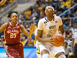 West Virginia Mountaineers guard Bria Holmes (23) drives to the hoop against the Oklahoma Sooners during the first half at the WVU Coliseum.