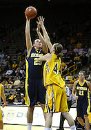 26 JANUARY 2009: Michigan center Krista Phillips (25) puts up a shot over Iowa center Megan Skouby (44) during the second half of an NCAA women's college basketball game Monday, Jan. 26, 2009, at Carver-Hawkeye Arena in Iowa City, Iowa. Iowa defeated Michigan 77-69.