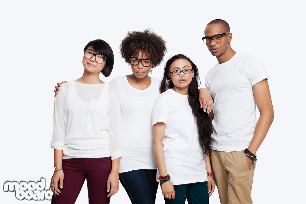 Portrait of confident multi-ethnic friends in casuals standing together over white background