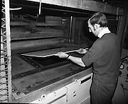 Pye Factory,fridge assembly line..1971..15.04.1971..04.15.1971..15th April 1971..The Pye factory which manufactured electrical appliances closed its doors in 1985. At the peak it Pye employed 1200 people and was the largest employer in the Dundrum area. Dundrum bowl was built on the Pye site when the factory closed, it too had its problems and closed in the early 90s due to flooding. on the site now stands the Dundrum Shopping centre which is now the centrepoint of Dundrum town centre..This picture shows an operative preparing the hydraulic moulding machine,which formed the liner for the fridges.