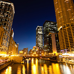 Chicago downtown and Chicago River at night with State Street Bridge and Marina City Towers.