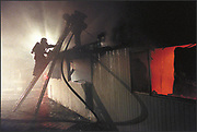 mondavifire.smd.11.10.00.news.standalone<br />Firefighters climb to cut ventilation holes on the roof of an unoccupied building that went up in flames on Michael Mondavi's property early Friday evening. The cause of the fire is still under investigation. SAMANDA DORGER/REGISTER
