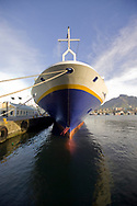 Bow of a cruise ship docked in the harbor in Cape Town, South Africa.