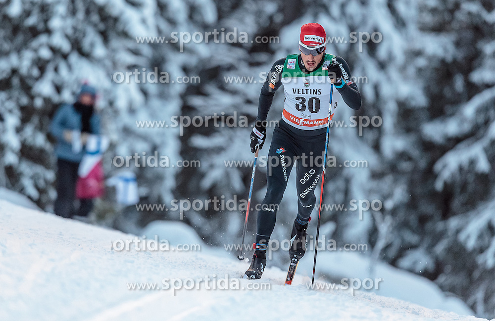 27.11.2016, Nordic Arena, Ruka, FIN, FIS Weltcup Langlauf, Nordic Opening, Kuusamo, Herren, im Bild Jonas Baumann (SUI) // Jonas Baumann of Switzerland during the Mens FIS Cross Country World Cup of the Nordic Opening at the Nordic Arena in Ruka, Finland on 2016/11/27. EXPA Pictures © 2016, PhotoCredit: EXPA/ JFK