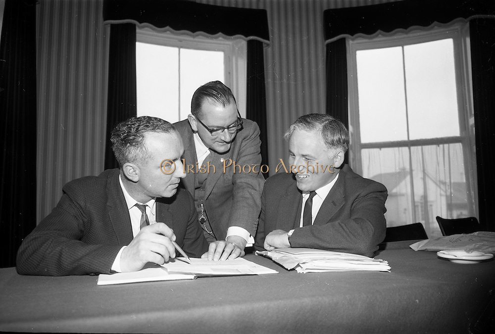 29/04/1965<br /> 04/29/1965<br /> 29 April 1965<br /> Planning for Junior Chamber of Commerce Convention. A final meeting of the planning committee of the 3 day Junior Chambers of Commerce 6th National Convention took place at the International Hotel, Bray Co. Wicklow the venue for the convention. The convention was to be addressed by Taoiseach  Sean Lemass and attended by 250 delegates from Ireland and continental countries. Picture shows: Mr. John Hegarty  (left), Convention Director, discussing arrangements with Mr Michael W. O'Reilly jr. (centre) President Dublin Chamber of Commerce and J.H. O'Reilly (right) Director, John Power and Son, sponsors of the Convention at the International Hotel.