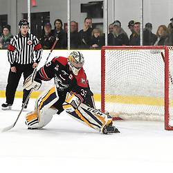 TORONTO, ON  - APR 10,  2018: Ontario Junior Hockey League, South West Conference Championship Series. Game seven of the best of seven series between Georgetown Raiders and the Toronto Patriots. Troy Timpano #33 of the Georgetown Raiders follows the play during the first period.<br /> (Photo by Andy Corneau / OJHL Images)