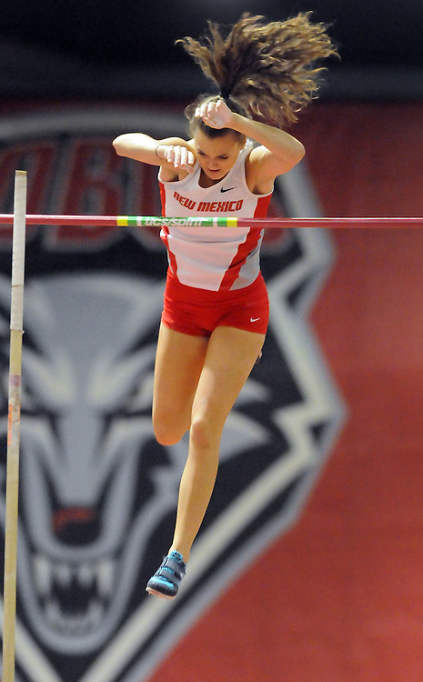 jt021117k/sports/jim thompson/ UNM's Katherine Whiting clears the bar in the Women's Pole Vault event. Saturday Feb.11, 2017. (Jim Thompson/Albuquerque Journal)