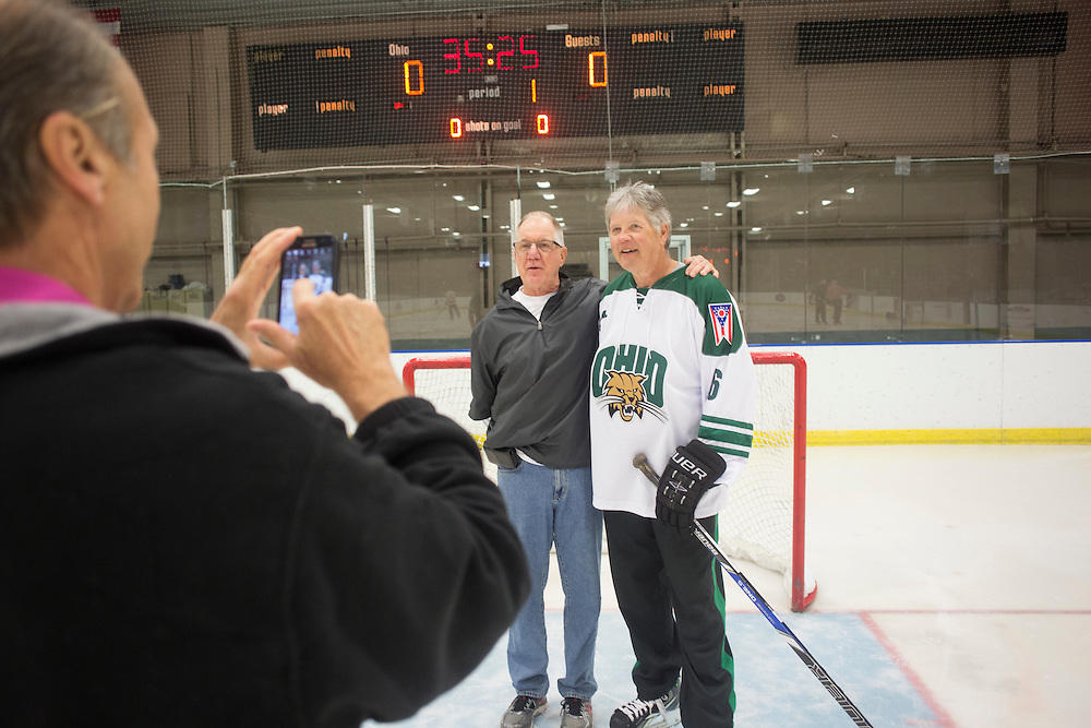 Pete Sisson takes a photo of Harry Williams and Dennis Corbett in Bird Arena on October 1, 2016.
