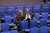 04 JUL 2002, BERLIN/GERMANY:<br /> Angela Merkel, CDU Bundesvorsitzende, und friedrich Merz, CDu, CDU/CSU Fraktionsvorsitzender, im Gespraech, Bundestagsdebatte zur Lage der Wirtschaft in Deutschland, Plenum, Deutscher Bundestag<br /> IMAGE: 20020704-01-065<br /> KEYWORDS: Gespr&auml;ch