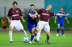 Danjel Rakuscek of Gorica between Jari Litmanen and Jukka Vanninen of Lahti  at 1st football match of 2nd preliminary Round of UEFA Europe League between ND Gorica and FC Lahti, on July 16 2009, in Nova Gorica, Slovenia. (Photo by Vid Ponikvar / Sportida)
