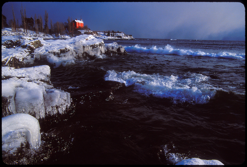 THE MARQUETTE LIGHTHOUSE DURING A LAKE EFFECT SNOW STORM ON LAKE SUPERIOR IN MARQUETTE MICHIGAN.