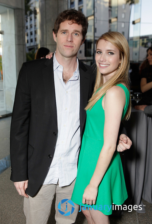 """BEVERLY HILLS, CA - JUNE 06:  Director Gavin Wiesen and Emma Roberts attend a Fox Searchlight screening Of """"The Art Of Getting By"""" at Clarity Theater on June 6, 2011 in Beverly Hills, California.  (Photo by Todd Williamson/WireImage)"""