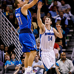 November 17, 2010; New Orleans, LA, USA; Dallas Mavericks power forward Dirk Nowitzki (41) of Germany shoots over New Orleans Hornets power forward Jason Smith (14) during the second half at the New Orleans Arena. The Hornets defeated the Mavericks 99-97. Mandatory Credit: Derick E. Hingle
