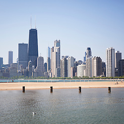 Photo of Chicago city skyline with John Hancock Center building, Willis Tower (formerly the Sears Tower), Trump Tower, and many other Chicago skyscrapers at North Avenue Beach. Photo is high resolution and was taken in May 2010.