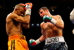 Nov 8, 2008; New York, NY, USA; Joe Calzaghe and Roy Jones Jr. trade punches during their 12 round Light Heavyweight Championship fight at Madison Square Garden in New York, NY.  Calzaghe defeated Jones via unanimous decision.