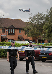 © Licensed to London News Pictures. 18/09/2017. London, UK. An aircraft takes of from Heathrow Airport as police guard a property in Stanwell, west London, where it is reported that terror suspect Yahyah Farroukh lived. Investigations are continuing into the failed bombing of an underground train at Parsons Green station on September 15, 2017. Detectives have searched three properties and have two people in custody. Photo credit: Peter Macdiarmid/LNP