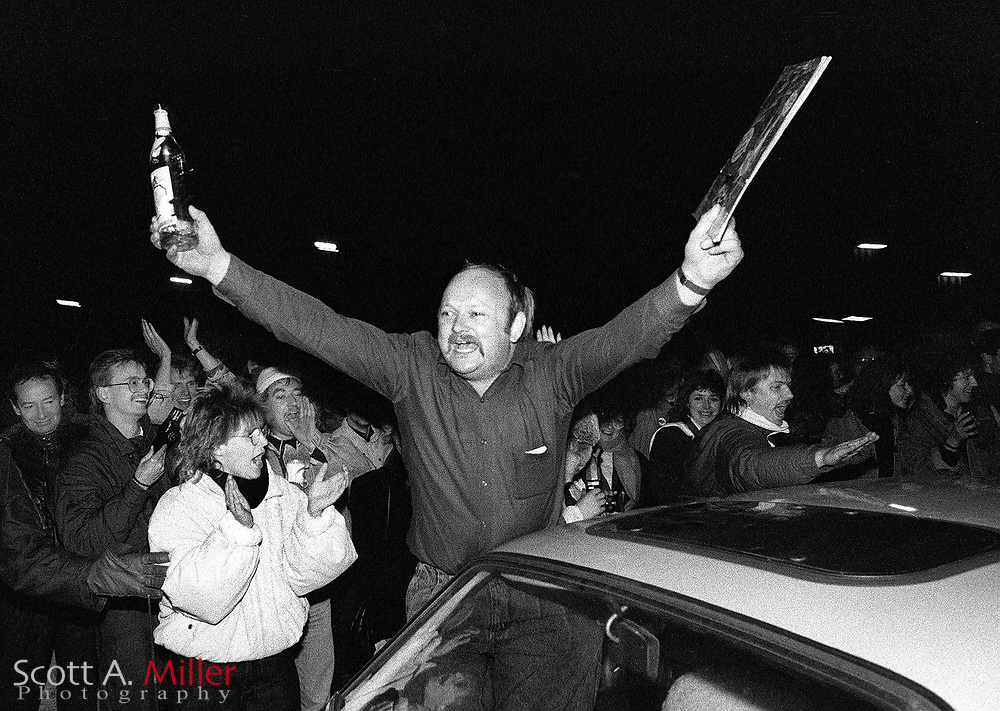 A man celebrates after crossed the intra-German border near Helmstedt, West Germany on Nov. 9, 1989. The borders between East and West Germany had been opened earlier in the day for the first time in nearly 40 years...©1989 Scott A. Miller