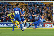 Dannie Bulman midfielder of AFC Wimbledon (4) stretches to challenge during  the Sky Bet League 2 Play-Off first leg match between AFC Wimbledon and Accrington Stanley at the Cherry Red Records Stadium, Kingston, England on 14 May 2016. Photo by Stuart Butcher.