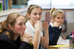 Scenes of  the Santa Rosa French-American Charter School in Santa Rosa,  California . Series of photos--  A group of students try to think of the correct answer for the teach and finally break out in laughter.