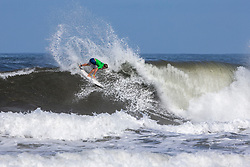 Benji Brand of Hawaii advances in 1st to Round 3 from Round 1 Heat 5 of the Hawaiian Pro at Haleiwa, Oahu, Hawaii, USA