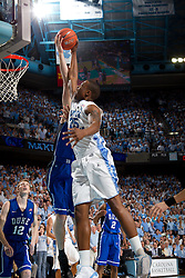 CHAPEL HILL, NC - MARCH 05: Justin Knox #25 of the North Carolina Tar Heels drives to the basket but is stopped by a Duke Blue Devils defends on March 05, 2011 at the Dean E. Smith Center in Chapel Hill, North Carolina. North Carolina won 67-81. (Photo by Peyton Williams/UNC/Getty Images) *** Local Caption *** Justin Knox